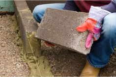 build-a-raised-bed-laying-first-course-of-blocks-2