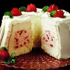 Strawberry Tunnel Cream Cake~T~ This is quick and easy using a store bought cake. The filling is Eagle brand , lemon juice, almond extract, chopped strawberries and whipped topping ( I use real whipped cream and serve it after it has chilled because I don't like whipped topping you buy.