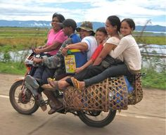 Six people, two wheels. Mindanao Philippines. But I've as many as 7 and 9 (2 were BABIES in a bucket). hehehe