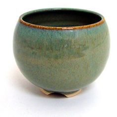 """thrown ceramic bowl. note rounded shape and the way the foot has been cut out to create """"feet"""" rather than a single circle"""