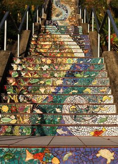 The 16th Avenue Tiled Steps project has been a neighborhood effort to create a beautiful mosaic running up the risers of the 163 steps located at 16th and Moraga in San Francisco. Sponsored by the San Francisco Parks Trust, artists Aileen Barr and Colette Crutcher started working on the project in January of 2003. The mosaic staircase was completed on August 18, 2004 with the help of over 300 neighbors, and over 220 neighbors who sponsored handmade animal, bird and fish name tiles.