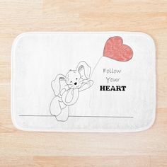 Give your bathroom a chic update with a soft, snuggly bath mat. Stylish and functional bathroom mats available in various sizes. Bath Mat Design, Heart Balloons, Follow Your Heart, Bath Accessories, Hare, Floor Pillows, Wall Tapestry, Duvet Covers, Cold