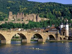 """Heedelberg, Germany, July 14, 2012    Our first trip was to the medieval town of Heidelberg!  Since it was not destroyed in WWII like many other German towns, the Aldstadt contains buildings from as far back as the 15th century!  This shot is of Schloss Heidelberg (in ruins) in the background, and the """"Old Bridge"""" which is now pedestrian only in the foreground."""