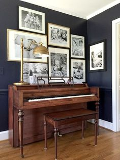 "Paint Color: ""Little Black Dress"" by Clark + Kensington at @acehardware (piano, living room, gallery wall)"