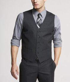 The groomsmen - charcoal pants and vests with a grey shirt (rolled up sleeves) and a patterned tie. Love this!