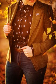 tweed blazer with a printed button up blouse and jeans