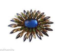 With its bold, vibrant blue center this daring Trifari floral brooch will spark oohs and aahs no matter how you wear it.  http://stores.ebay.com/Stuff4Uand4U