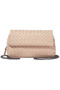 Bottega Veneta's beige leather shoulder bag is a sleek and compact option for busy days, weddings or day-long parties. Hand-woven by artisans using the label's signature intrecciato technique, it opens to reveal a zipped section and a pouch compartment. We love that you can detach the chain strap and carry it as a clutch.
