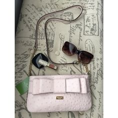 Kate Spade Charm City Ostrich Crossbody bag Authentic KS Charm City Presley bag. Such a cute bag for spring and summer! Ballet pink color with gold chain and leather strap. Four credit card slots inside. kate spade Bags Crossbody Bags