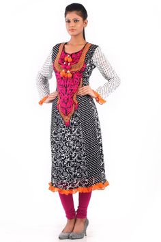 This designer printed kurti in black & white is apt for all those gatherings where you want to look simple yet elegant. A subtle orange frilled is added to this product to give it a mesmerising look. This is further beautified at the neckline that carries tassels.This can be paired with matching bottoms to attain a desired look.