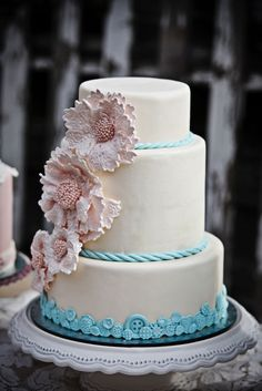 love the blue wrap and flowers coming down the cake