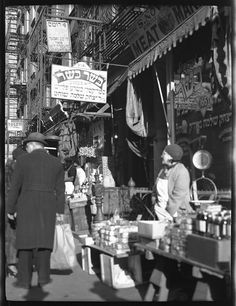 Woman selling many kinds of cake at 164 Orchard Street, New York. 1933 December 2. Center for Jewish History, NYC via Flickr.