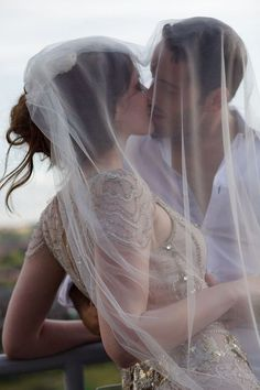 photo with your new husband under your veil in a gorgeous taupe embroidered wedding gown
