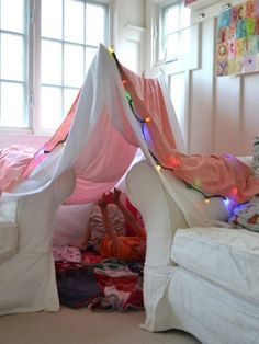 9 creative indoor forts | Today's Parent:  Make a fort and crawl in together, read, camp out, watch a movie...Doesn't have to be elaborate...2 broom handles and a sheet over the couch turns the sick bed into a haven of cuddles, snuggles and fun.