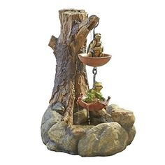 A water feature with a turtle and frog sitting in umbrellas. A playful waterfall for your patio or decking area.
