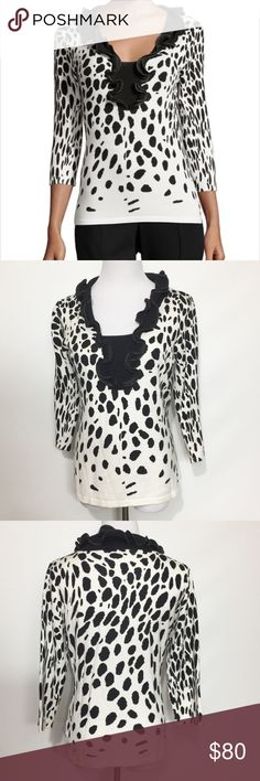 NEIMAN MARCUS RUFFLE NECK ANIMAL PRINT SWEATER * Neiman Marcus animal-print knit sweater with piped faux-leather (polyurethane) trim. * Ruffled V neckline; inset. * Three-quarter sleeves. * Fitted silhouette. * Straight hem. * Pullover style. * Rayon/nylon; hand wash. * Imported. Neiman Marcus Sweaters V-Necks