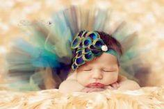 This is the cutest newborn picture I've ever seen!! Peacock feather headband. $21.95