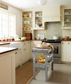 Love the apron sink, love the stove back splash, upgrade the stove to a viking and change the butchers block and it would be the perfect kitchen!