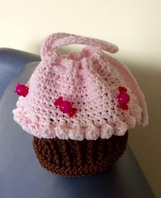 My version of a cute child's handbag - a easy free pattern from http://dearestdebi.com/crochet-cupcake-purse. She has a good selection of patterns on her site - thank you.