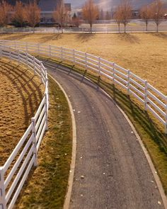 Sweeping curves are no problem for the white or black steel board Buckley Fence. Elegant, long-lasting, and safe for horses. Horse Arena, Horse Stables, Horse Farms, Horse Paddock, Pasture Fencing, Horse Fencing, Horse Barn Plans, Future Farms, Horse Property