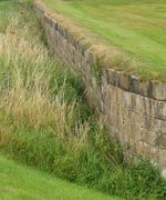 The ha-ha wall at Seaton Delaval Hall  What's in a wall? A simple structure, built to serve a purpose - surely that's all there is to say? Not so in the case of the quirky breed of walls called ha-has, built in the 17th and 18th Century on country estates of the landed gentry.    Ha-ha walls consist of a sunken stone wall-its top level with the garden, with a deep ditch on the far side: an effective barrier to livestock.