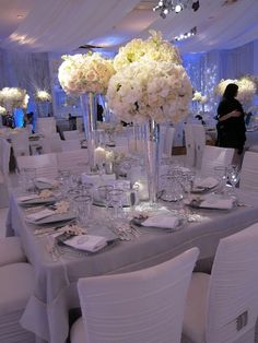 I like the idea of elevated centerpieces, so that they make a statement without getting in the way of guests looking at each other.