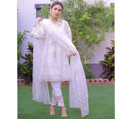 in a pristine white crafted and mirror embellished Ensemble and gorgeous 💕💕 Styled by Pakistani White Dress, Pakistani Formal Dresses, Eid Dresses, Pakistani Dress Design, Party Wear Dresses, Fashion Dresses, White Anarkali, Cotton Dresses, Bridal Dresses