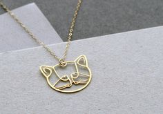 cat necklace cat jewelry cat head golden by WildThingStudio