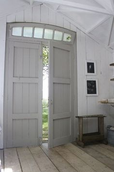 Love the gray doors with the old floor.