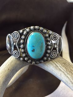 Respect your elders.....vintage Navajo bracelet with natural American turquoise. Love all the detail in the stamped applied drop beads and scroll work. Circa 1940-50