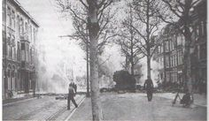 Adelheidstraat. 10 mei 1940. De brandweer blust een brand die is uitgebroken nadat een Duits vliegtuig is neergestort.