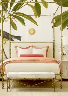 Bedroom Bliss. Palm leaf wallpaper and a gold bamboo-motif canopy bed.