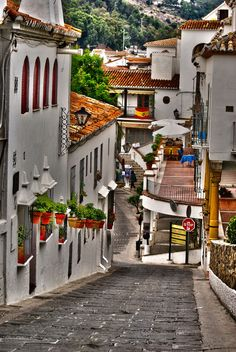 Mijas, Spain. Loved our holiday here. Such a pretty place and typically Andalucian. We were lucky  enough to be there at the time of the fiesta for the Virgen de la Pena. Very colourful and people dressed in flamenco costume.