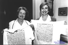 Lady Bird Johnson and Hillary Clinton holding up tee-shirts with the names of all the First Ladies, 1994