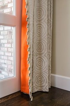 great idea ~~ pop of color on the back of a neutral drape panel