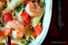 ¼ Cup of Butter Fresh Parsley ½ Pound of Jumbo Shrimp – Uncooked, deveined 1 Pound of Penne Pasta 4 ounces butter 1 pint heavy cream 2 Tablespoons of Bread Crumbs 1 Cup of Parmesan Cheese 1 Roma Tomato Diced Baked Parmesan Shrimp Recipe, Baked Shrimp Recipes, Seafood Recipes, Cooking Recipes, Seafood Meals, Copycat Recipes, Drink Recipes, Pasta Recipes, Shrimp Dishes