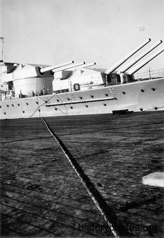 11 in forward triple turrets of a German battleship Scharnhorst: it was intended that she and sister Gneisenau would have 6 x 15 in guns, but the design was not ready, so they received 9 x 11 in of the type fitted to the (6 gun) pocket battleships  on a 'temporary' basis: they were never replaced.  It mattered little: the 11 in was a fine design; accurate, with a high rate of fire and long range (Scharnhorst's first hit on carrier HMS Glorious in June 1940 was at 26000 yards).
