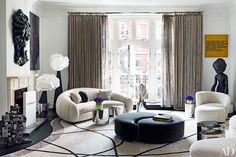 London townhouse by François Catroux, a Jean Royère sofa (left) and a Vladimir Kagan sofa, lounge chair, and ottoman (all clad in sheepskin) mingle with Mauro Fabbro lamps from Alexandre Biaggi and a pair of custom-made ottomans; the rug is by Tai Ping. Living Room Decor Inspiration, Decoration Inspiration, Interior Inspiration, Decor Ideas, Room Ideas, Decorating Ideas, Interior Decorating, London Townhouse, Living Room Modern