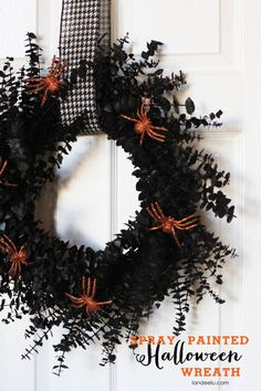 Spray Painted Halloween Wreath from landeelu.com   Spray paint an old, tired wreath black to give it new life for Halloween!