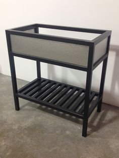 Contemporary Art Websites Steel bathroom vanity base Hammered stainless steel inserts with remaining steel frame finished in a