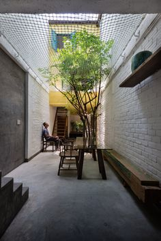 Saigon House by a21studio is filled with house-shaped rooms at different levels