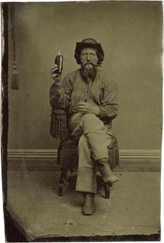ca. 1870's, [tintype portrait of a bearded gentleman smoking a cigar and holding up a bottle of whiskey]