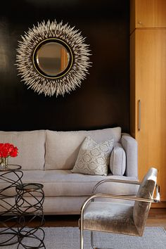 Cozy den with grey fabrics and black walls. Quill mirror for texture. Nicole Yee Interiors
