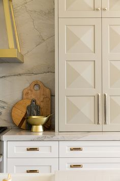 Two Tone Kitchen Cabinet Paint Color. Gray and white kitchen cabinet paint color. The gray cabinet paint color is Benjamin Moore Gray Mist and the lower white cabinet paint color is Benjamin Moore Sea Pearl. Alice Lane.