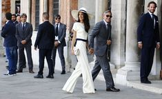 Amal Alamuddin's Best Wedding LooksStella McCartney For the civil ceremony that took place on Monday, Alamuddin sported a custom Stella McCartney ensemble that brought to mind Bianca Jagger's iconic choice back in 1971. Photo: Pierre Teysott/AFP/Getty Images