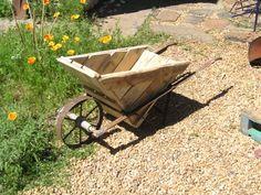 Pallet wheelbarrow #Garden #Pallet, #Wheelbarrow More pallet patio, gardening, DIY furniture ideas and inspiration at http://pinterest.com/wineinajug/passion-for-pallets/