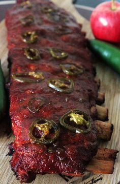 These Apple Jalapeno Smoked ribs are on a whole nother level. Sweet and Spicy come together in a magical union. We looooooove us some ribs. Something about the messy hands, messy face, and full acknowledgement that the flavor of what you Traeger Recipes, Rib Recipes, Roast Recipes, Grilling Recipes, Sauce Recipes, Venison Recipes, Cooker Recipes, Spicy Ribs Recipe, Barbecue Sauce