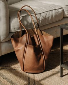 A collection of rich brown, warm beige, and black tones are an essential neutral for spring summer and beyond. Easy, fuss free bags that can be worn multiple ways. From the city to the beach, Are Studio's leather only gets better with age and wear. Get one before they're gone.