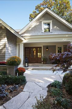 "Shingles Paint Color is ""Cabots Fieldstone"" and trim paint color is ""Benjamin Moore # 942 Marble White""."