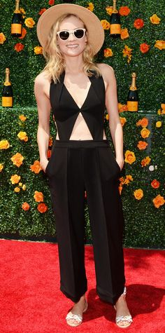 Diane Kruger took the risque route for the Veuve Clicquot Polo Classic and went for a revealing black cut-out Roland Mouret one-piece, complete with a straw hat, white frames, and white strappy sandals.